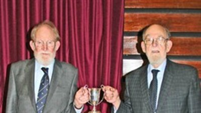 Some of the School's old trophies were on display and here Bob and John Spilsbury hold the Junior Victor Ludorum Cup, which Bob won in 1948 and John in 1942, making them the only pair of brothers at the School both to win that particular award.