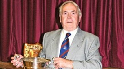 Norman Peacock holds the Rose Bowl for cricket, which is presumably the first time he has touched it since he won it nearly 50 years ago in the late 1940's!