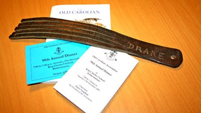 "And here's a more detailed picture of this notorious instrument of torture, shown with the Old Carolian magazine and 98th Annual Dinner ticket and Menu, to give an idea of scale. And note the name ""Drake"" scratched in the cosh... presumably to ensure it didn't get mistaken for anybody else's cosh within the School!"